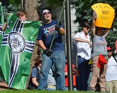 "The green ""Kek"" flag was displayed b6y some supporters of the ""Stop Sharia Law"" rally in Denver"