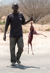 Roadside man and fresh antelope