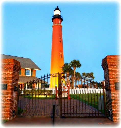 ponceinletlighthouseatdusk lighthouse ponceinletflorida gate fence florida twilight dusk scenic