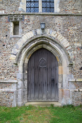 west door and crowned image niche