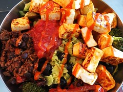 Omg. My own version of a #chipotle #burritobowl with #vegan #sofritas, #sriracha #tofu & #fajita veggies (plus tons of other veggies). So. Good. #whatveganseat