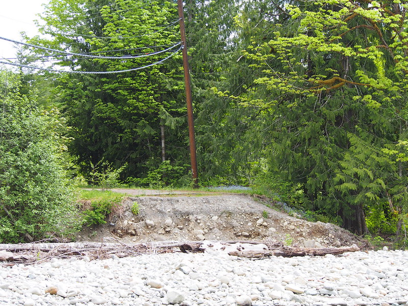 Old Cascade Highway Washout: The Old Cascade Highway originally crossed the Miller River on a truss bridge a bit further east of here, but the river changed course in 2011 and washed the road out.  There's a river without a bridge and a bridge without a river now, thus this is impassible.