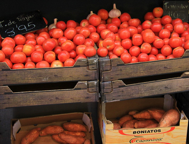 Spanish tomatoes and sweet potatoes on sale at Girona Food Market
