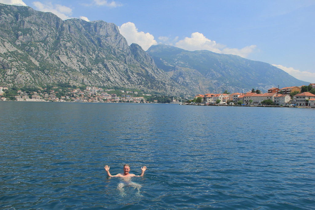 Stu swimming in the warm waters of Kotor Bay