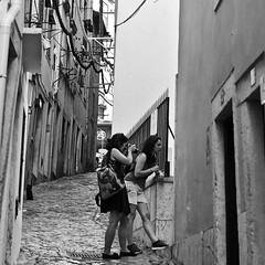 Two girls photographing at Alfama