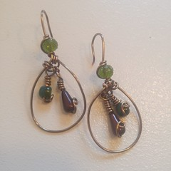A set of earrings I made with vintage bronze wire. Green and maroon glass beads. . . . #christinasjewelrycreations, #cjccustomjewels, #jewellery, #jewelry. #jewelryart, #jewellerydesign, #jewelrydesigner, #earrings, #vintagebronze, #vintage, #vintagejewel
