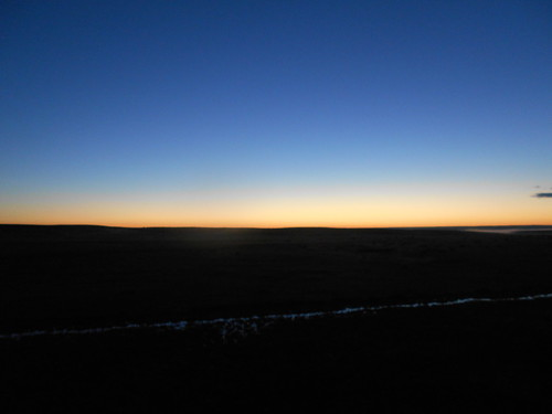 水平線に日が沈む