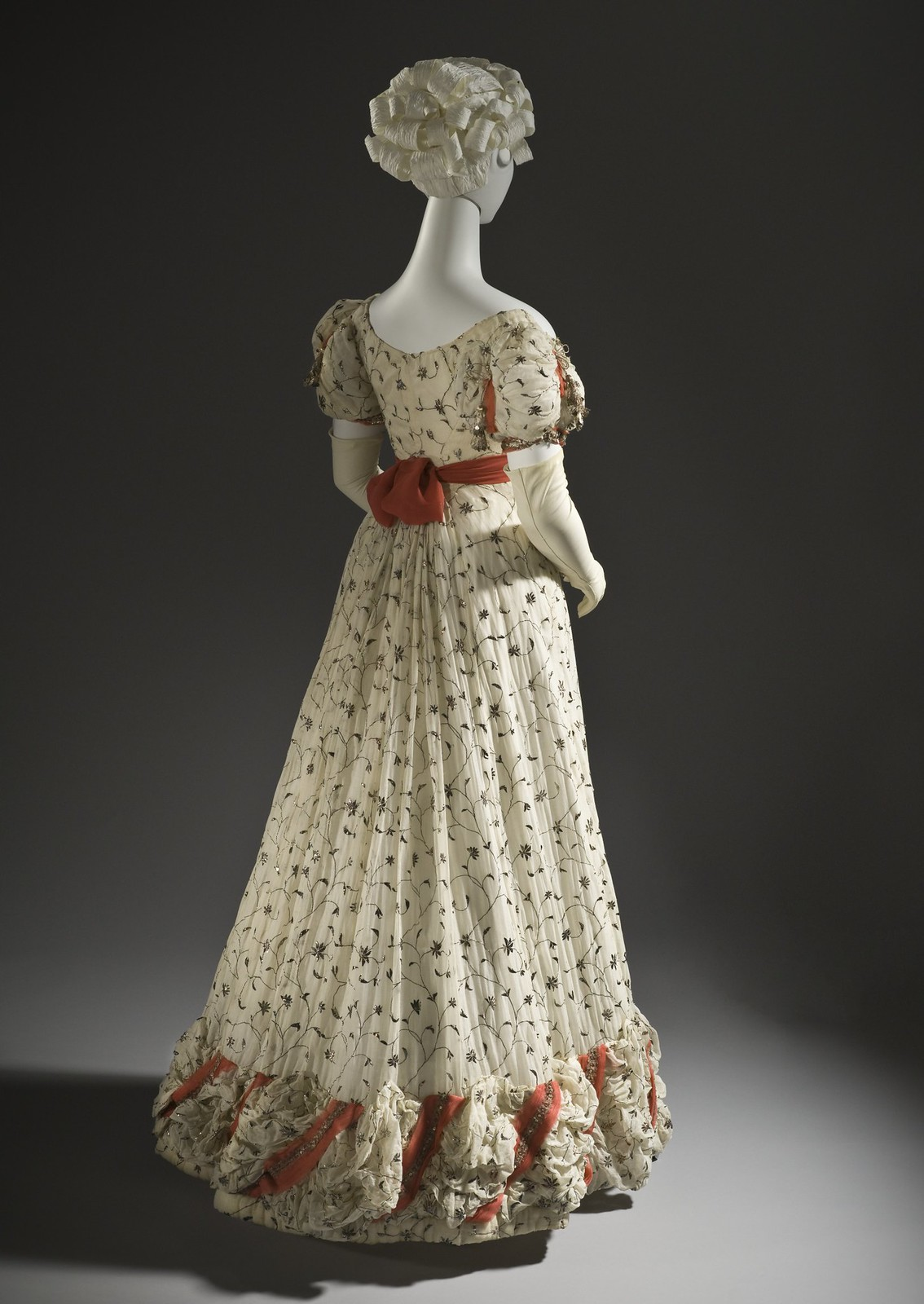 1820 Ball gown. British. Cotton plain weave with metallic thread embroidery and silk ribbons with metallic passementerie and tassels. LACMA