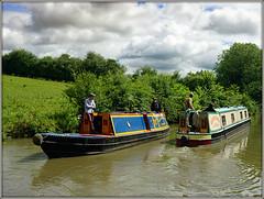 Narrowboats passing.