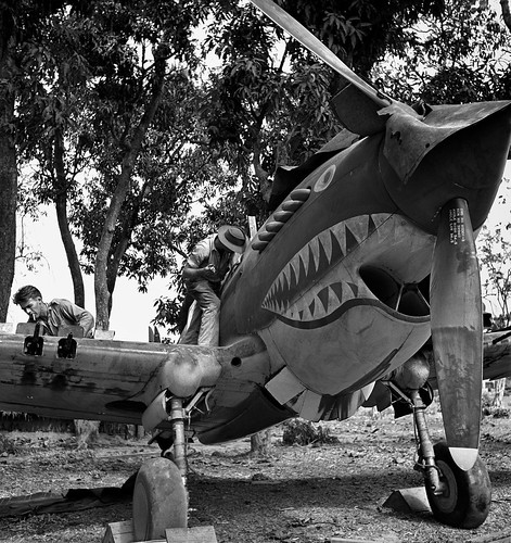 (Pat Hanley) and  (Jim Musick) rearm a Curtiss P-40 Tomahawk from The Flying Tigers on Mingaladon airfield in Burma in 1942.