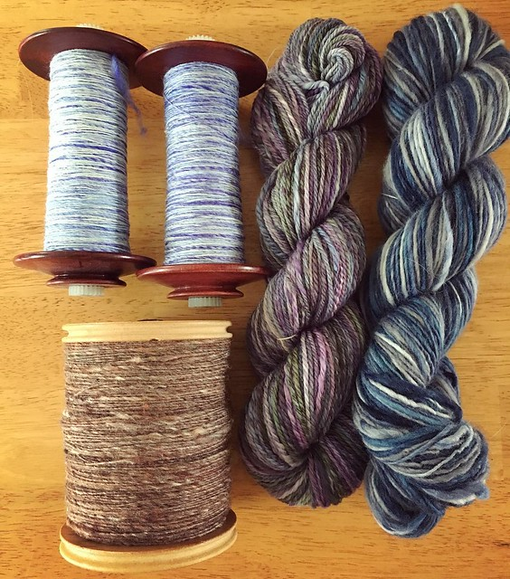 Yarn so far. Two skeins on the right done, two bobbins top left to be plied, one full brown bobbin (and another to make just like it). #spinning #tourdefleece #teamcatitude