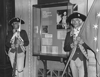 """Photograph of Honor Guard Standing by """"The Creation of an American Army"""" Exhibit"""