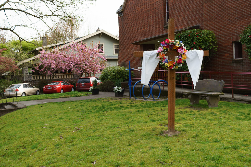 A wreath of flowers hangs on the cross on Easter at Augustana Lutheran Church in Portland, Oregon