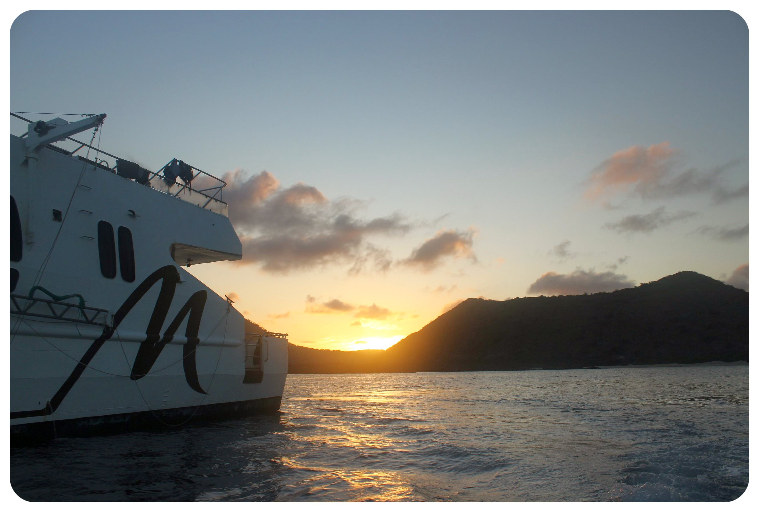 galapagos majestic yacht at sunset