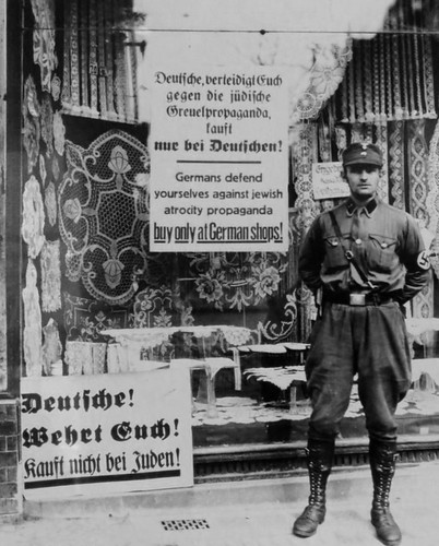 A German stormtrooper enforcing the boycott of Jewish businesses