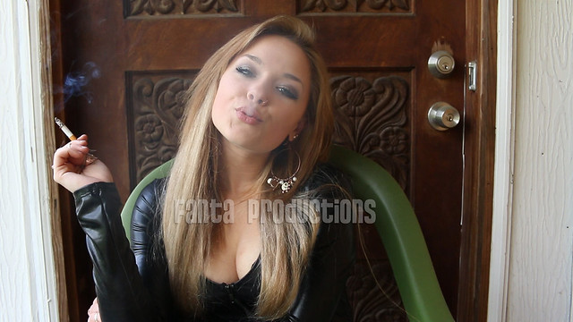 Natasha Smoking in Black Leather Top