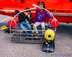 Kids in the MH-65D Basket