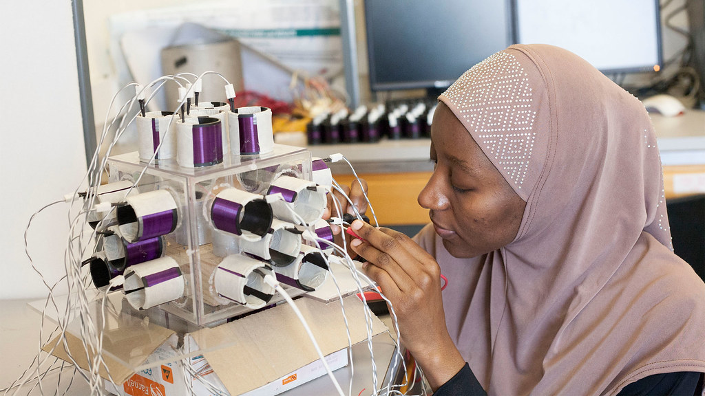 A postgrad student works on an electronics project