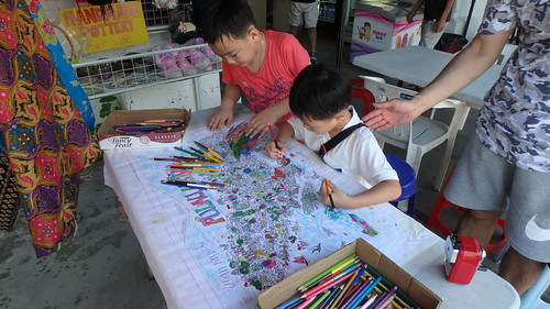 Colouring the Pulau Ubin Fun Map at Uncle Lim's shop at Pesta Ubin 2017