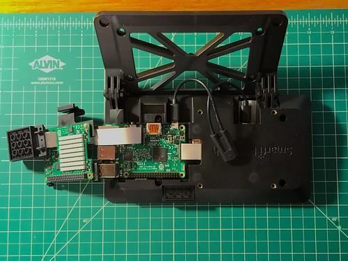 Raspberry Pi camera ribbon connected through door and Sense HAT