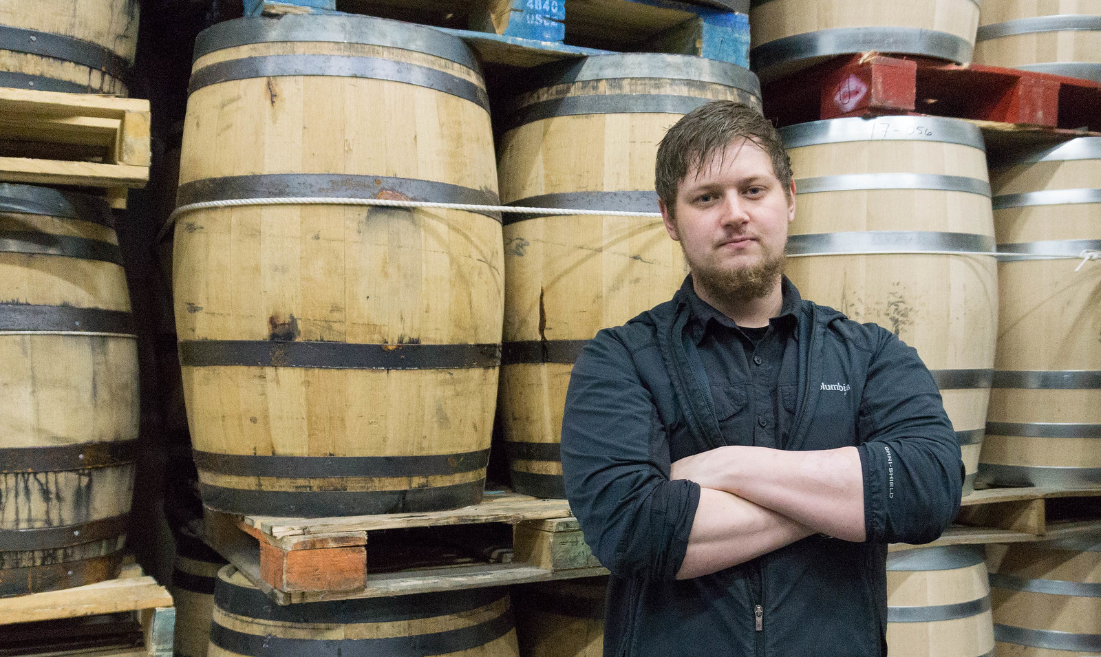Distiller Andrew Holt in Front of Barrels Full of Whiskey - Sugarlands Distilling, Gatlinburg, Tenn.