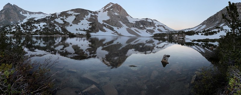 Dawn calm snow reflections from our campsite on Paiute Lake