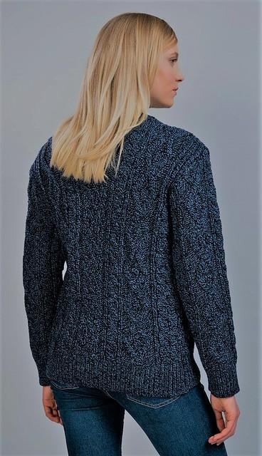 Aran sweater style. Knitwear by sexy blonde girl