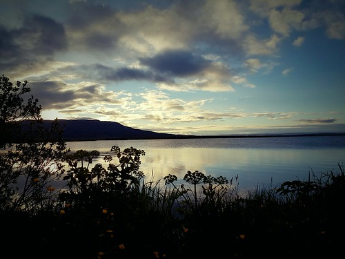 lake laugarvatn iceland sunrise summer water reflection clouds sky oeiriks