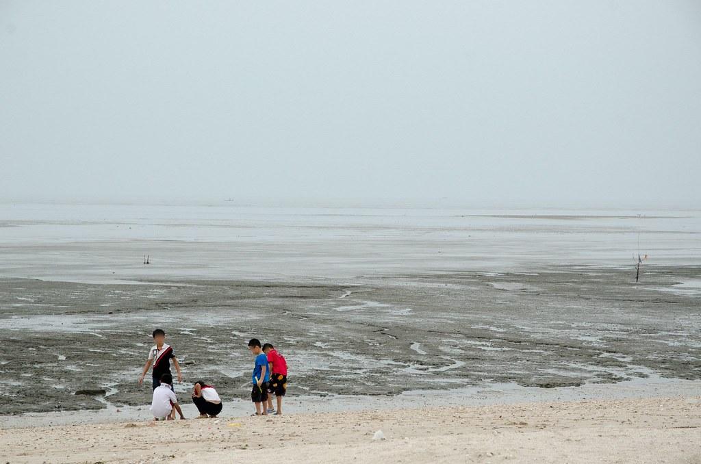 Kids playing on the beach at Pantai Redang Beach, Sekinchan