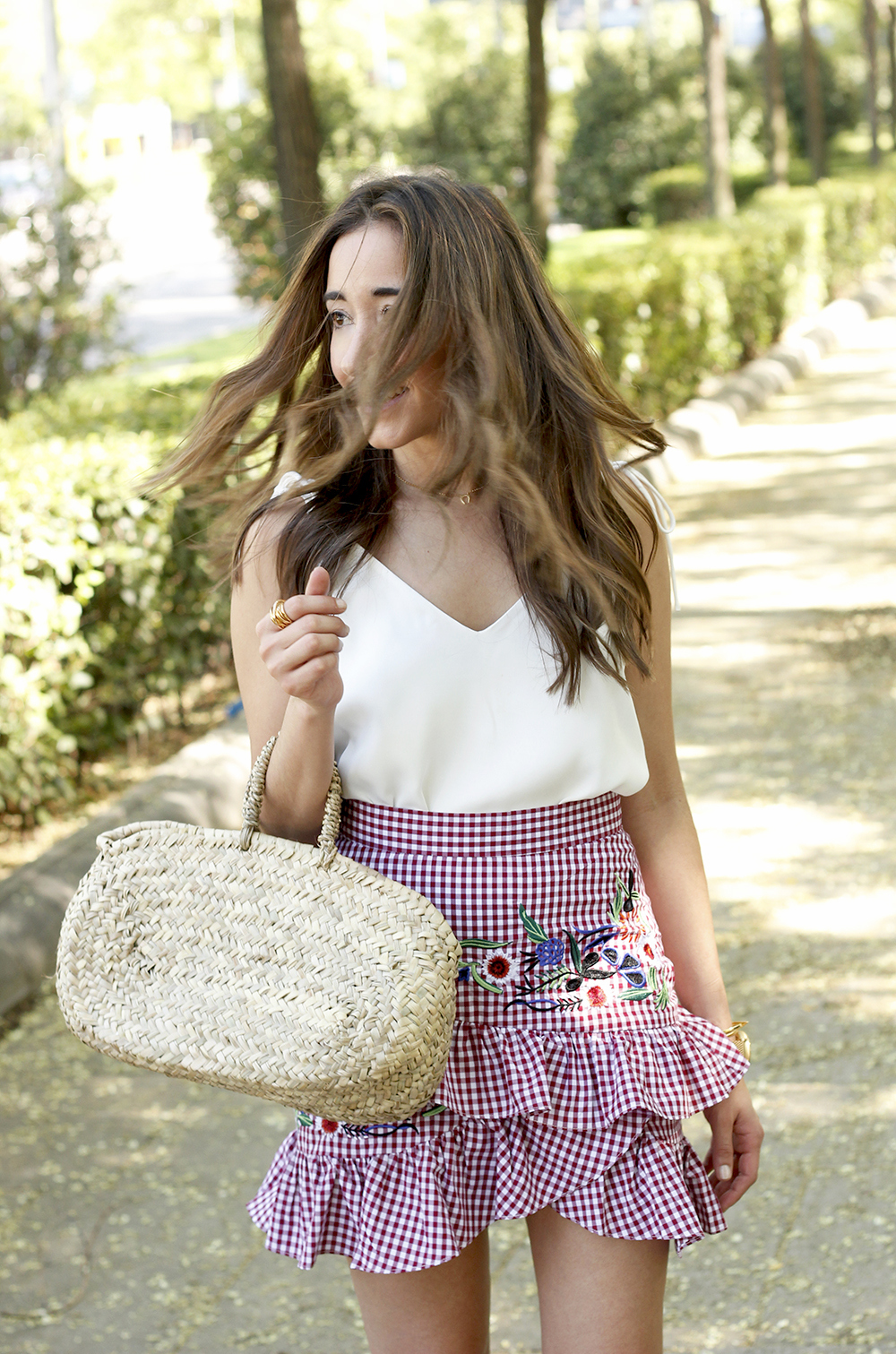 Vichy skirt with embroidered flowers rafia bag heels summer outfit style06