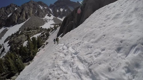 219 GoPro video of hiking with Microspikes and Ice Axes across a sloping snowfield on the Paiute Pass Trail