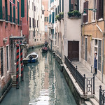Gondolier on a side canal