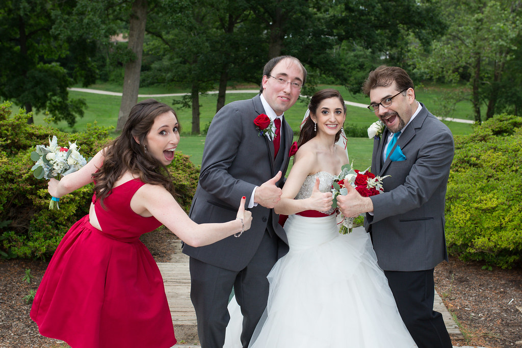Silly wedding party picture with siblings.