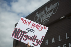 Protester outside the St. Anthony Village police station