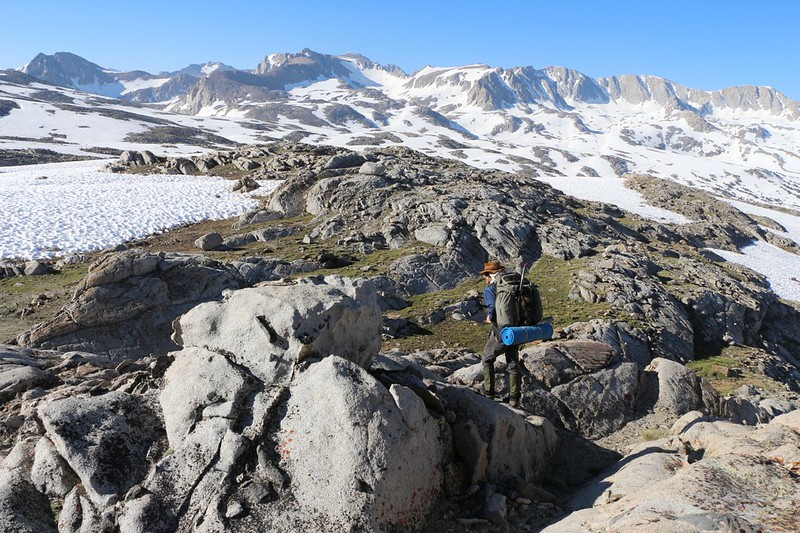 Hiking across the granite ridges, avoiding snow when possible, on our way to Paiute Pass