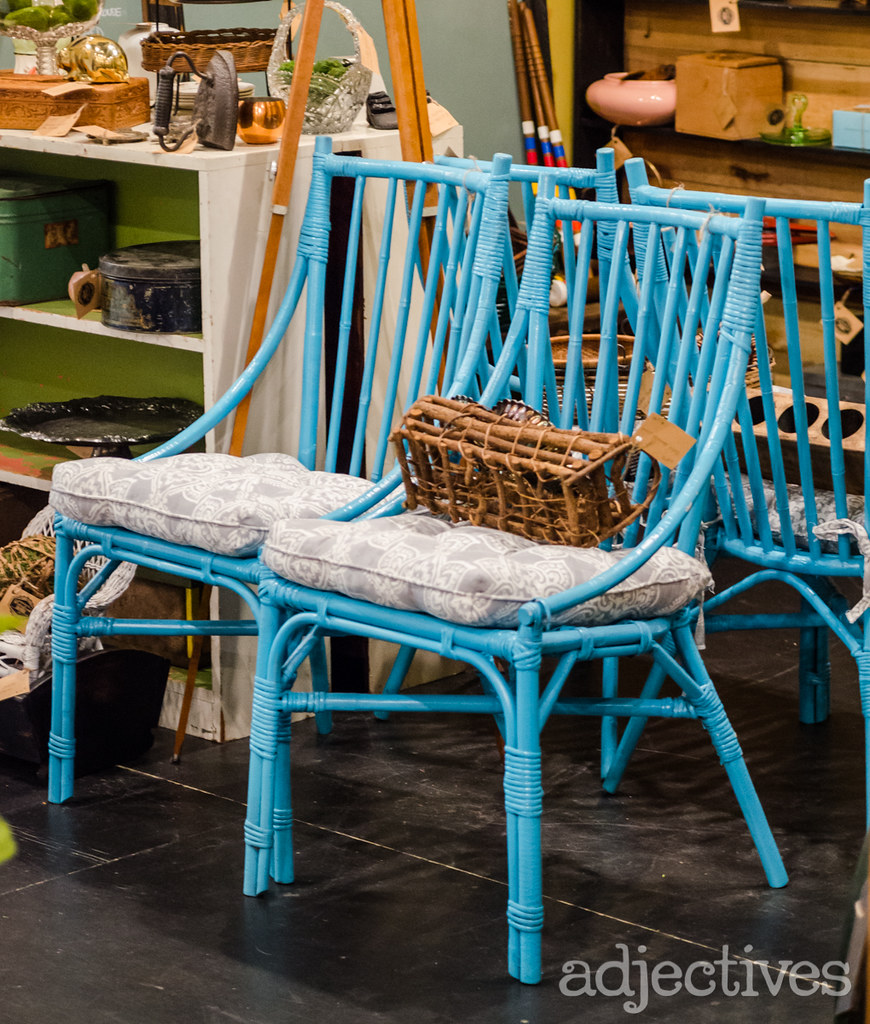 Vintage Rattan chairs with paisley cushion in  Adjectives Winter Garden