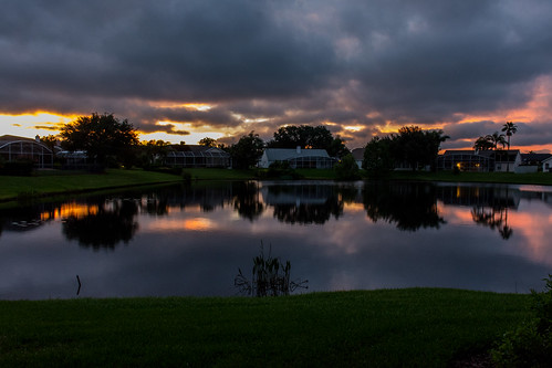 pond hunterscreek home sunset backyard reflection orlando florida