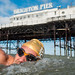 Swimming club member mark swimming past Brighton Pier by lomokev