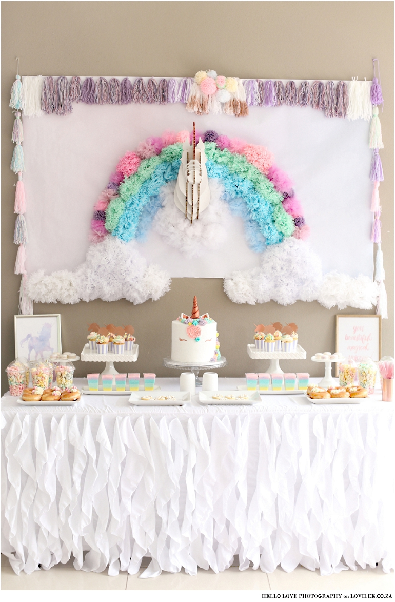 Unicorn party inspiration and candy table with unicorn cake