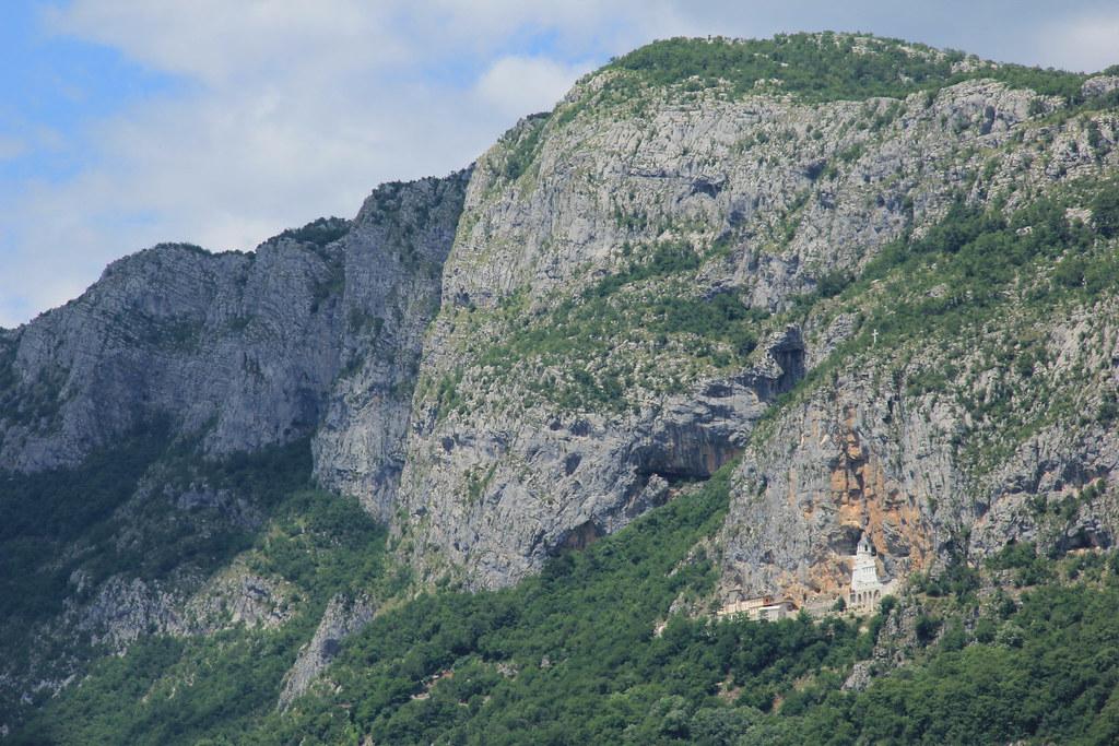 Craggy rock faces of the Zeta Valley make Ostrog Monastery look tiny!