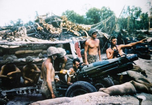 3rd Marine Division)  firing a 75 mm pack howitzer M-1 on  Bougainville December 1943.