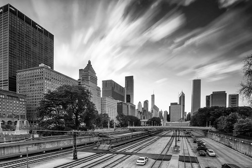2017 july chicago illinios kevinpovenz midwest street streetphotography downtown blackandwhite bw canon7dmarkii sigma1020 city cityscape train tracks buildings building skyscrapers evening eveningsky sunset sky clouds longexposure