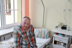 Senior in bed in assisted living facility