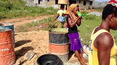 On a good day these women earn $3 fetching water for construction sites, Ushafa Village, Abuja, Nigeria, #JujuFilms