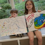 Younger Cedar Lane members holding up signs for the Climate March, 4.28.17