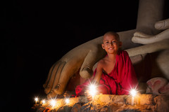 A boy in buddhism set fire with candle in bagan