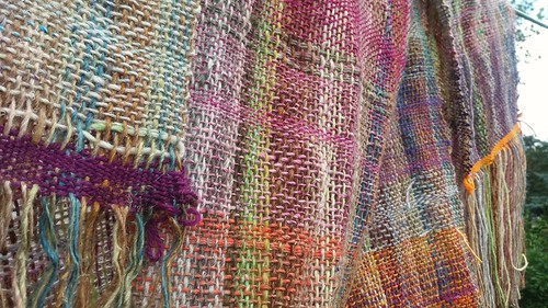 "Weaving with Noro on a rigid heddle loom. This is a scarf or shawl ~13"" x 82"" . There were a few broken warps, but it wasn't  too bad.  I used the Noro silk sock yarn and a variable dent reed of about half and half 5 and 7.5 dent.  Like many or  most peop"