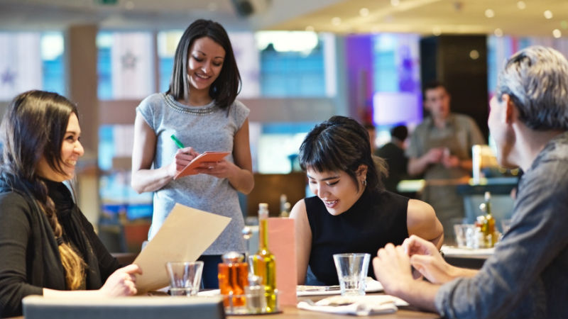 Diners order food from a waitress