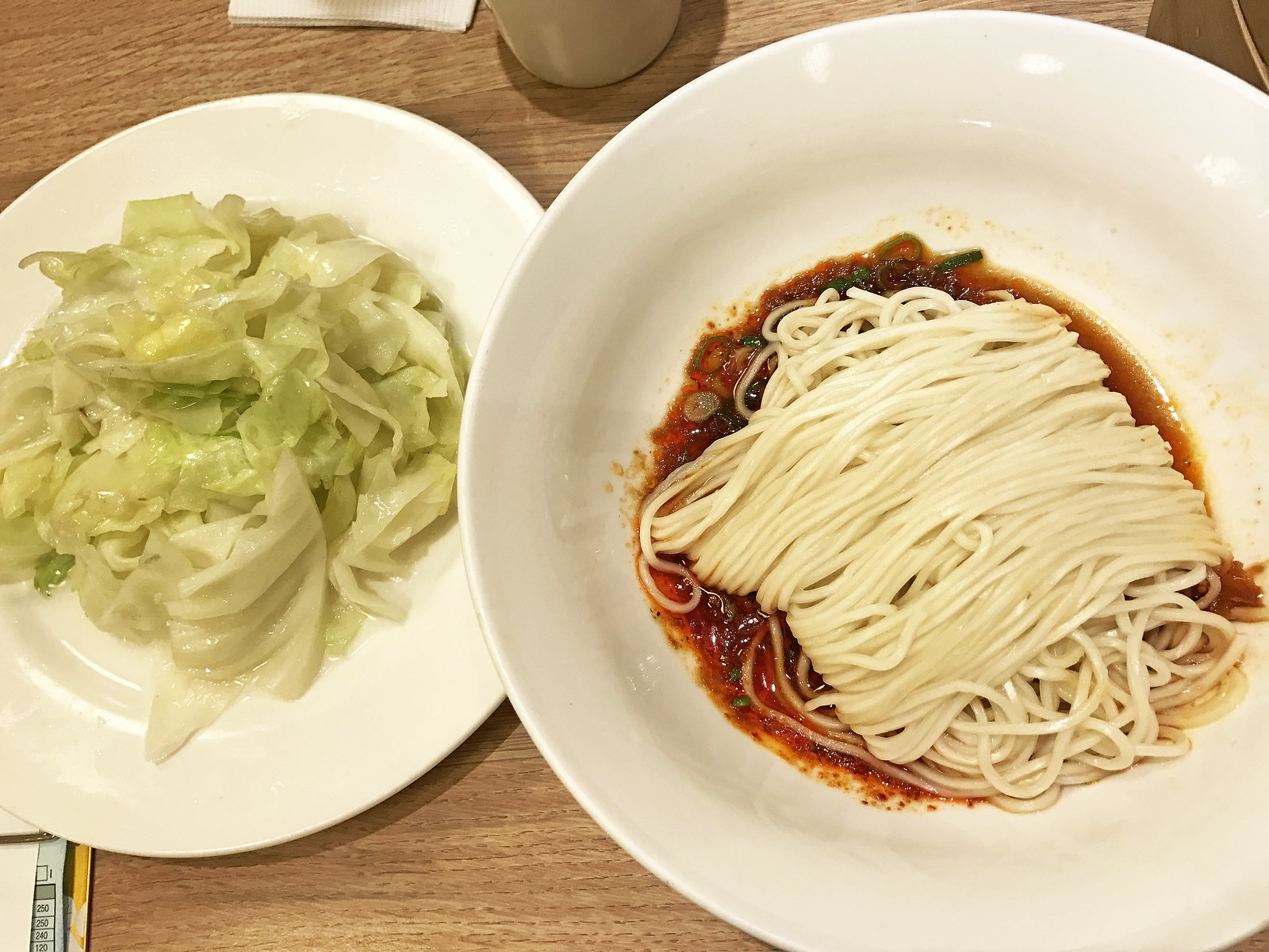 Stir-fried cabbage and house special spicy noodles