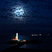 A Lighthouse under the full moon